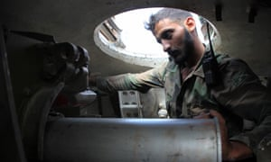 A Syrian soldier is seen inside an army tank on the southern outskirts of Aleppo.