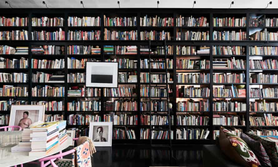 Floor to ceiling and wall to wall books shelves, full of books