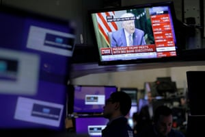 U.S. President Donald Trump is seen on a screen during his meeting with bank executives as traders work on the floor of the New York Stock Exchange (NYSE) in New York City, New York, U.S., March 11, 2020. REUTERS/Andrew Kelly