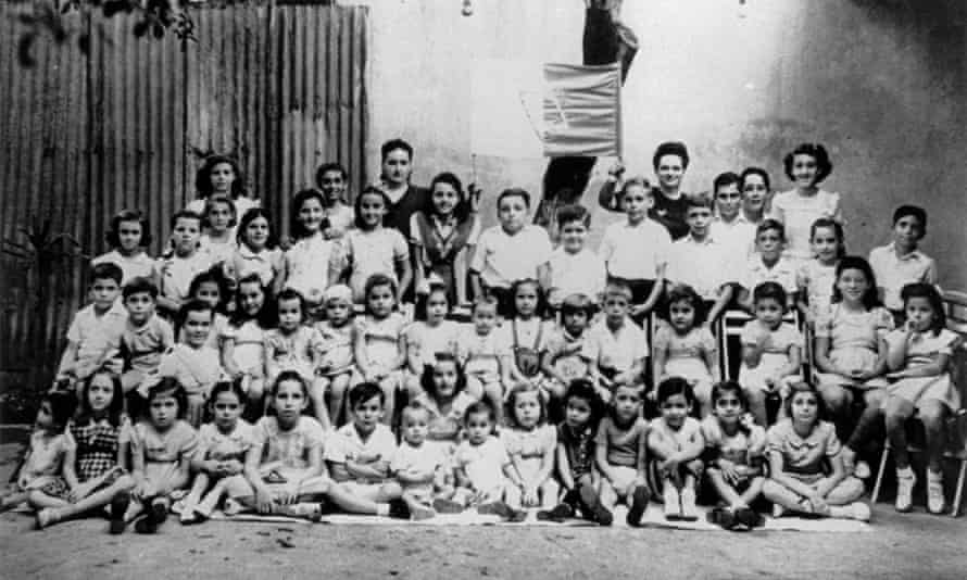 Group photograph of about 50 children with their Hebrew and Jewish religion teacher Fanny Lapscher in Port of Spain.