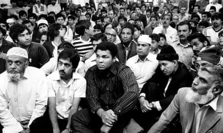 A familiar face among the faithful: Muhammad Ali sits among the congregation at Birmingham's Central Mosque, after shunning a special seat placed for him to face his fans and fellow-worshippers on 7 August 1983.