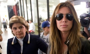 Rachel Uchitel arriving at Los Angeles airport with Allred just behind her