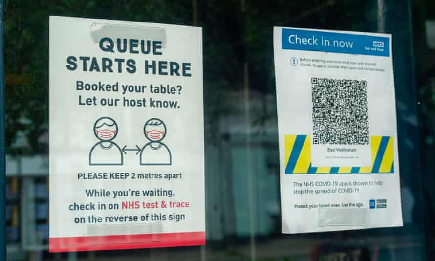 Social distancing signs in a restaurant window in Wokingham, Berkshire