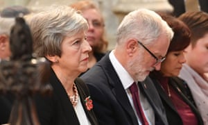 Theresa May with Jeremy Corbyn and his wife Laura Alvarez (right) at the service this afternoon for MPs and peer in St Margaret's church in Westminster to honour parliamentarians who gave their lives during the First World War.