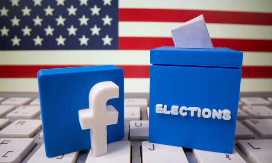 A 3D-printed elections box and Facebook logo are placed on a keyboard in front of U.S. flag in this illustration taken October 6, 2020.