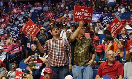 Supporters of Donald J Trump hold placards during a rally inside the Bank of Oklahoma Center in Tulsa, Oklahoma.