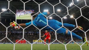 Ospina saves Jordan Henderson's penalty.
