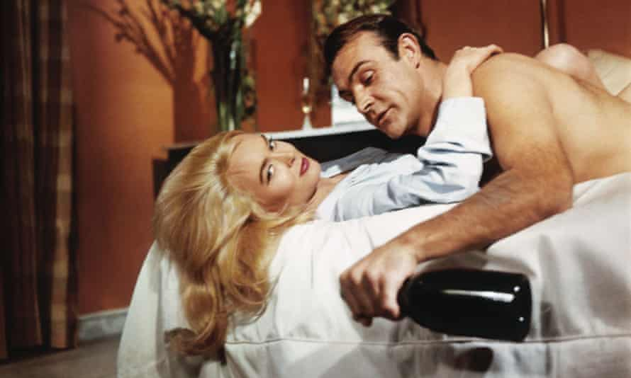 Sean Connery in Goldfinger, 1964, with Shirley Eaton as Jill Masterson.