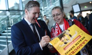 Labour's Brexit secretary Keir Starmer signs a poster for a delegate
