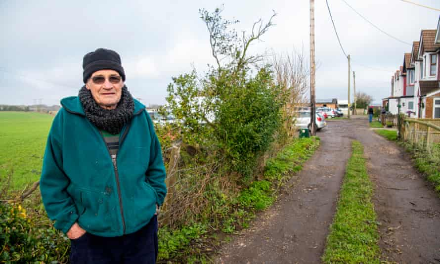 Mick Palmer, who lives in Guston, in front of the area of the planned lorry park.
