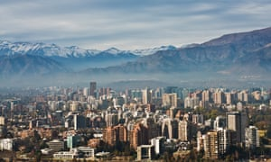 Santiago skyline with the Andes mountains in the background.
