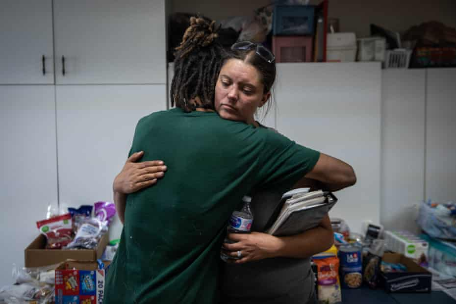 Sayyed Bey hugs Valerie O'Dai at the Bly fire station.