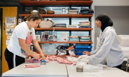 Arbenita Zhigolli (left) and Nada Abdi enjoy a handicrafts lesson at Lintulaakso school in Espoo, Finland.