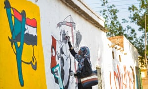 A woman paints a mural in Khartoum, where people have been renaming streets in honour of men and women killed during anti-government protests