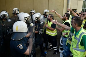Miners from Eldorado gold mine in northern Greece argue with riot police today.