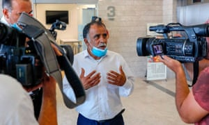 Hussein Dawabsha, Ali's grandfather, speaks to journalists
