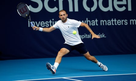 Dan Evans retrieves a forehand in his win over Ryan Peniston