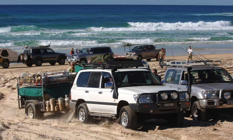 Tourists in four-wheel drive vehicles traverse Fraser Island
