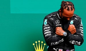 Lewis Hamilton gestures on the podium in tribute to the Black Panther actor Chadwick Boseman, who died on Friday.