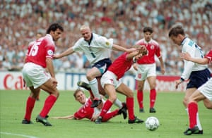 Gazza: 8 Jun 1996. England's Paul Gascoigne squeezes the ball through a group of Switzerland players to Teddy Sheringham in the opening match of Euro 96. The game at the old Wembley was drawn 1-1 as England embarked on a memorable home tournament.
