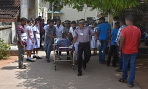 One of the blast victims is brought to a hospital in Colombo