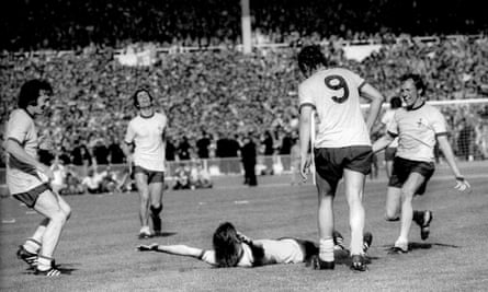 Charlie George falls to the floor in celebration after scoring the winning goal in the Cup final in 1971.