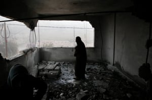 A Palestinian man checks the house of man accused of the fatal September stabbing of an Israeli-American after it was partially demolished by Israeli forces in village of Yatta.