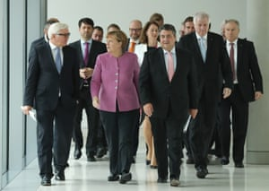From left: foreign minister Frank-Walter Steinmeier, chancellor Angela Merkel, Social Democrats chair Sigmar Gabriel and his Bavarian Christian Democrats counterpart, Horst Seehofer, arrive at the Bundestag in Berlin.