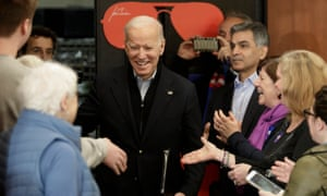 Joe Biden shakes hands as he arrives to talk to voters in Hampton, New Hampshire, on 9 February.