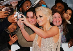 All smiles … Rita Ora with fans on the red carpet before the ceremony
