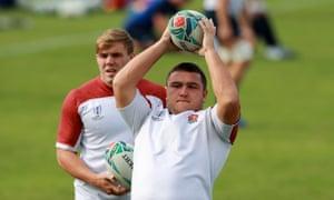 England hooker Jamie George, centre, throws the ball in training alongside fellow hooker Jack Singleton, left.