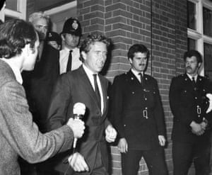 Lord Snowdon after being fined for driving carelessly when his car collided with that of a photographer