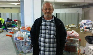 Kostas Moisides in the warehouse where he has delivered several bags of food.