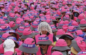 Seoul, South Korea. Members of the Korean Confederation of Trade Unions use their mobile phones in a protest against the government