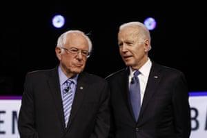 Bernie Sanders and Joe Biden talk before a Democratic debate in Charleston, South Carolina.