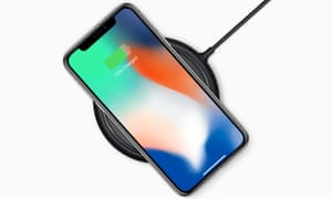 The iPhone X on wireless charger.