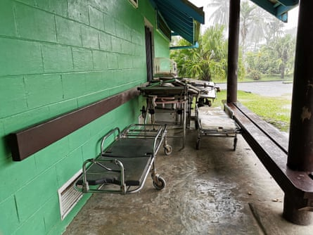 Worn and broken gurneys sit outside one of the wards at the Warangoi health clinic in East New Britain, PNG.