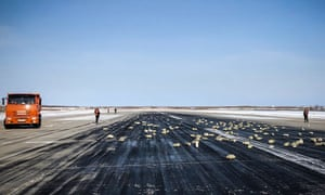 Gold, silver and precious metal bars on the runway of the airport of Yakutsk, Siberia. A plane dumped more than three tons on the runway of an airport following a problem during take-off.