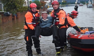 Members of the Fire and Rescue service evacuate an elderly resident to dry land in Bentley, Doncaster.