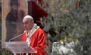 Pope Francis leads the Palm Sunday mass in St. Peter's Basilica without public participation due to the spread of Covid-19 on April 5.