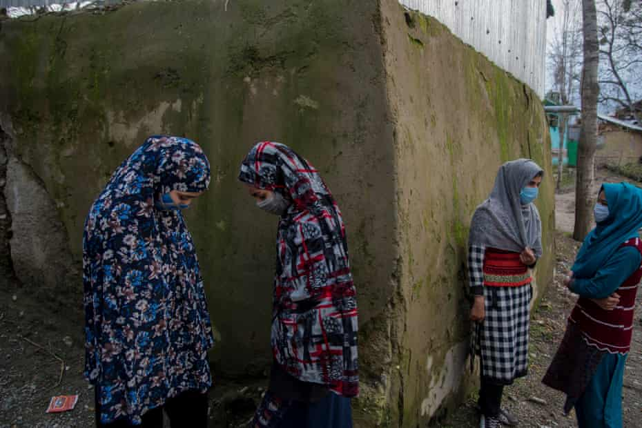 Kashmir. Baramulla. Mubashira talks to her friends while seeing them off after they visited her home. The friendship and the bond they share have brought a new life in them since schools opened again after nearly 18 months. 2021
