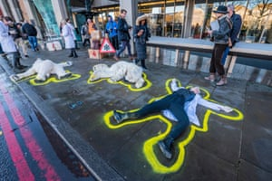 London, UK: Extinction Rebellion activists protest against Arctic shipping pollution as delegates arrive for an international shipping summit