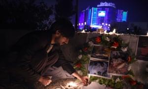 Afghan civil society activists attend a candlelight vigil for nine children killed in village of Shahi Khel