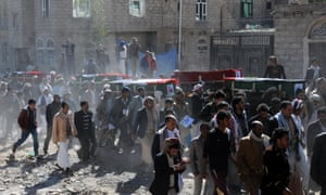 Yemeni people carry coffins of people killed in airstrikes in Sana'a