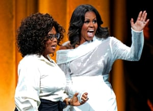 Chicago, US. Michelle Obama waves to fans at the opening of her multi-city book tour, joined by friend Oprah Winfrey