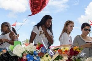 Fans gather at a makeshift memorial outside the XXXTentacion funeral & fan memorial in Florida.