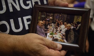 David Califa holds a photograph of him and his group taken a few days before the terrorist attack in 2016.