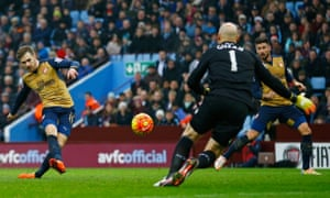 Arsenal's Aaron Ramsey fires into the net for their second goal.