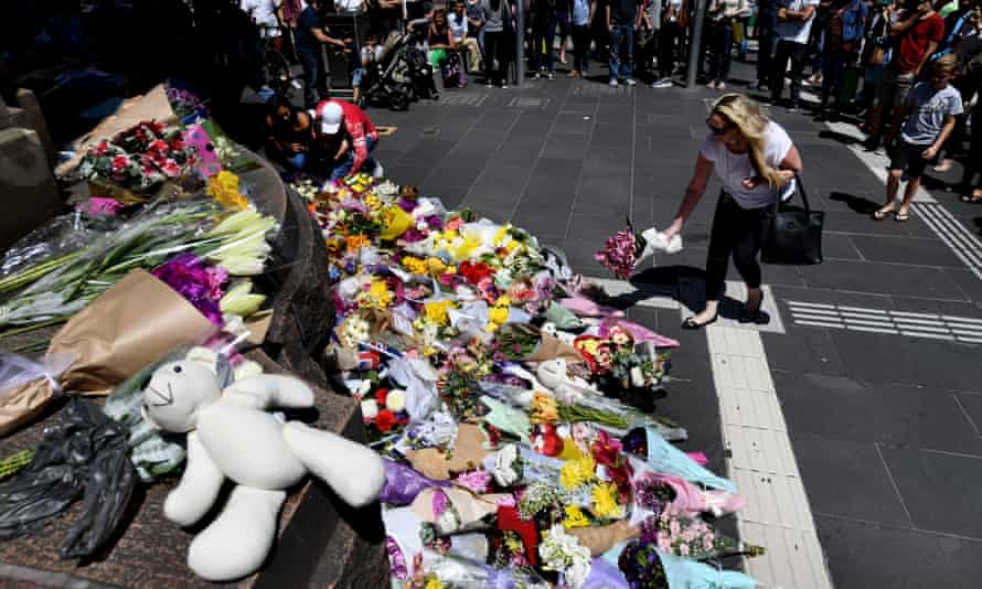 Mourners leave flowers on the corner of Bourke and Elizabeth Street after James Gargasoulas killed six people and injured dozens when he drove through Melbourne's Bourke Street in January 2017.