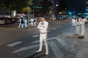 Jesus Méndez stands on the main avenue next to Plaza Garibaldi waiting to stop cars with other musicians, hoping to find a paying client. At times there are dozens of musicians here trying to stop passers-by from about 6pm until well past midnight.